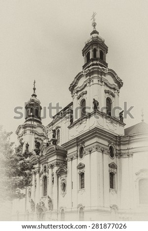 Church of Saint Nicholas (Saint Nicholas Cathedral) at Old Town Square, Prague, Czech Republic. Built in 1704 - 1755 it is described as most impressive example of Prague Baroque. Antique vintage. - stock photo