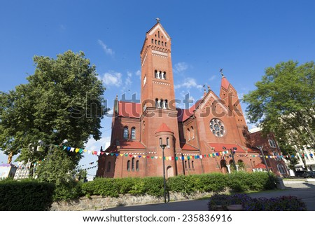 Church of Saints Simon and Helen also known as the Red Church is a Roman Catholic church on Independence Square in Minsk, Belarus  - stock photo