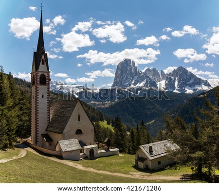 Church of San Giacomo near Ortisei in Italy with the Dolomites on the background