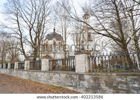 Church of St. Alexander Nevsky and old cemetery in Ust-Izhora town, St.Petersburg suburb, Russia. - stock photo