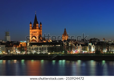 Church of St. Martin in Cologne. Night Quay in Cologne. View of the Church of St. Martin.