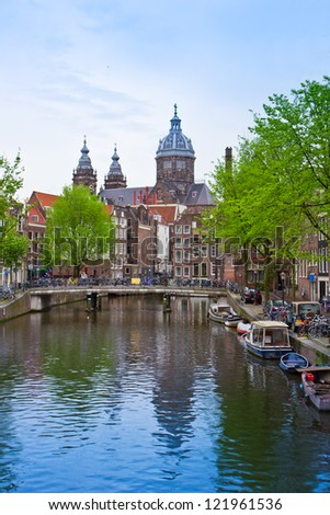Church of St Nicholas, old town canal, Amsterdam, Holland - stock photo