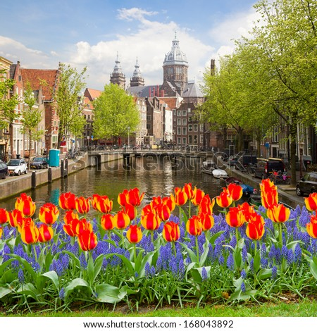 Church of St Nicholas, old town canal, Amsterdam, Netherlands - stock photo