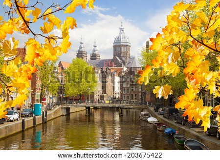 Church of St Nicholas, old town canal at fall day, Amsterdam, Netherlands - stock photo