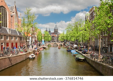 Church of St Nicholas, old town canal at spring day, Amsterdam, Netherlands - stock photo
