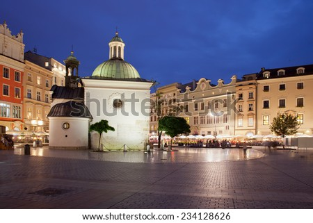 Church of St. Wojciech in Krakow, Poland at night. Located on the Main Square in the Old Town. - stock photo