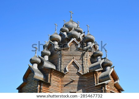 Church of the Intercession in the style of Russian wooden architecture in the Nevsky Forest Park in St. Petersburg. - stock photo