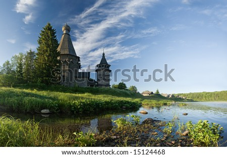 Church on coast of the river - stock photo
