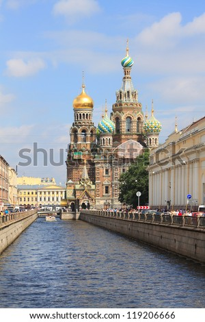 Church on Spilt Blood and Griboyedov Canal in St. Petersburg, Russia. This Church was built on the site where Tsar Alexander II was assassinated and was dedicated in his memory. - stock photo