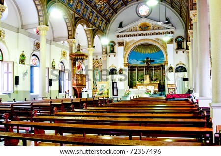 Church sanctuary before a wedding ceremony - stock photo