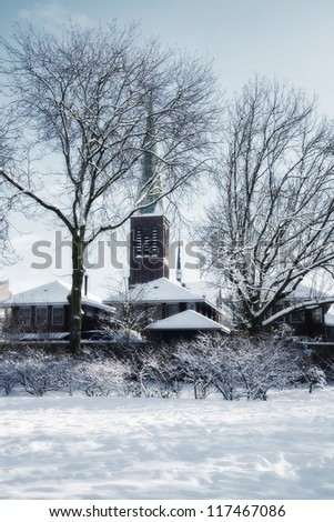 church silhouettes in winter dutch village