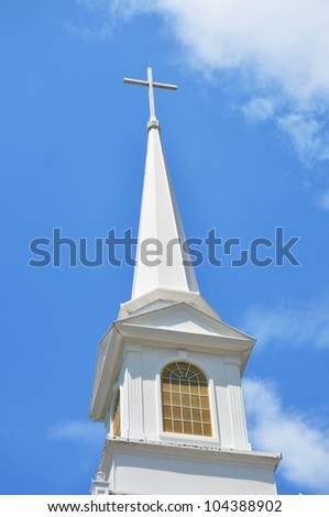 Church Steeple with cross against blue sky - stock photo