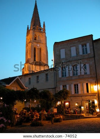 Church tower and city center of Saint Emilion in the Bordeaux, France: world famous for its red wine - stock photo