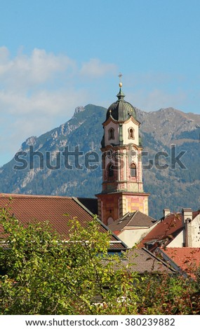 church tower mittenwald against karwendel mountains, bavarian tourist attraction - stock photo