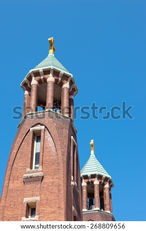 church towers and spires in saint paul of art nouveau architecture style against blue sky - stock photo