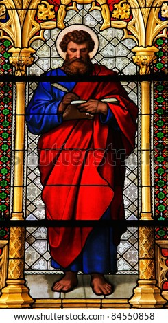Church window in the Dom of Cologne, Germany, depicting Saint Mark the Evangelist. - stock photo