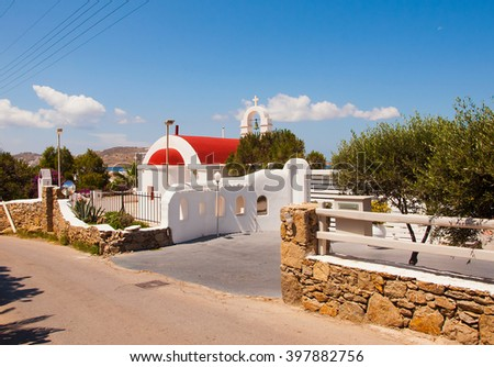church with red roof at Greek town of Mykonos - stock photo