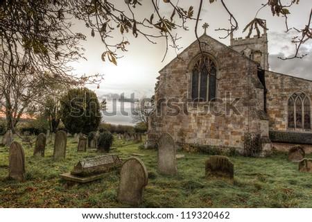 Church yard at dusk - stock photo