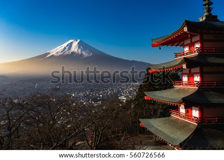 Chureito pagoda in foreground and mount fuji in background during sunrise time. Beautiful nature and human culture.
