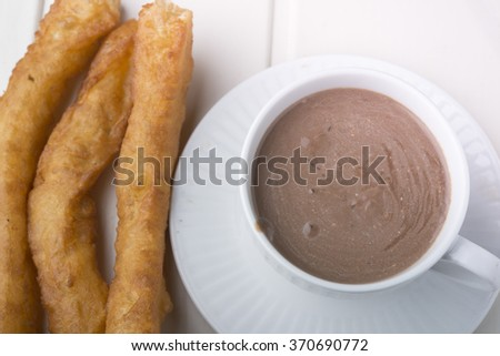 churros con chocolate, a typical Spanish sweet snack - stock photo