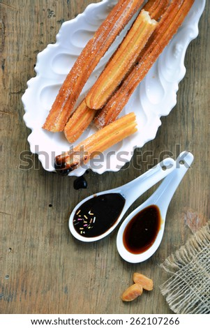 churros with chocolate and caramel - stock photo
