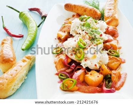 Chutney with steamed mackerel icefish fillet fruits and herbs. Shallow dof. - stock photo