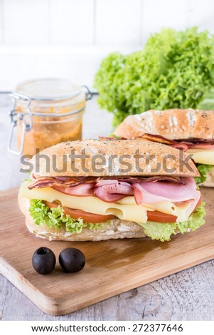 Ciabatta sandwich with bacon and cheese on wooden boarde,selective focus - stock photo