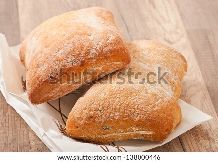 ciabatta with cheese on a wooden table - stock photo