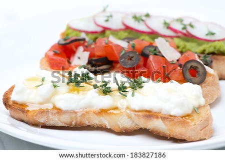 ciabatta with goat cheese, honey and thyme on a plate, close-up, horizontal - stock photo