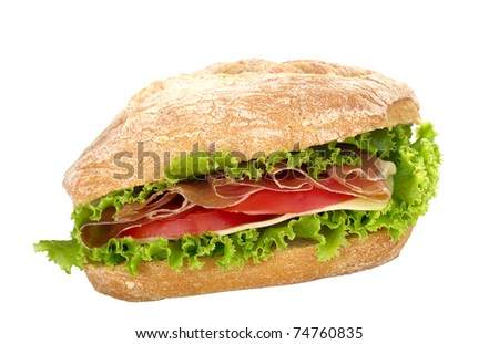 Ciabatta with lettuce, ham, cheese and tomato (Selective Focus, Focus on the front)