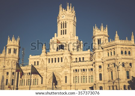 Cibeles Palace is the most prominent of the buildings at the Plaza de Cibeles in Madrid, Spain. This impressive building is the Madrid City Hall. - stock photo