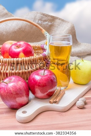 Cider - alcohol hot apple drink and apples on wooden table