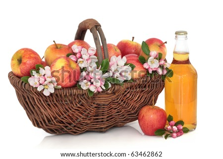 Cider bottle with red apples in a rustic wicker basket with apple flower blossom, isolated over white background. Gala apple variety. - stock photo