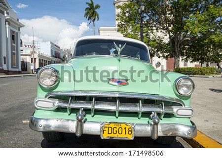 CIENFUEGO, CUBA -  MAY-21-2013:a typical old style American car that tourists can find going to visit Cuba. In other nations these cars are for collectors and it's difficult to find them - stock photo