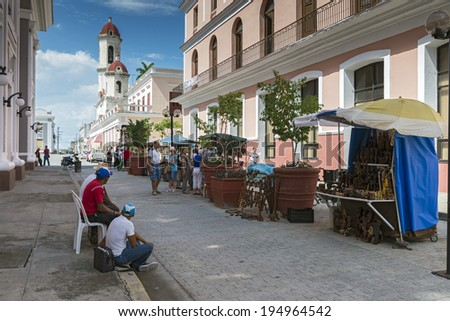 CIENFUEGOS, CUBA - MAY 7, 2014: Street market selling crafts and souvenirs on a street in Cienfuegos, Cuba