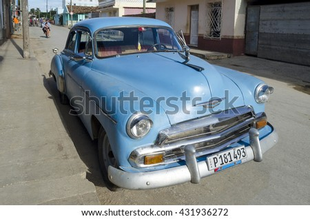 CIENFUEGOS - DECEMBER 2: Old blue american car on the street on 2 December 2015 in Cienfuegos, Cuba.