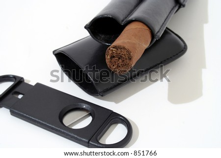 Cigar and accessories on white background