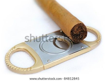 cigar and cigar scissors is very close - stock photo