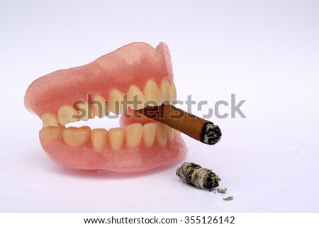 Cigar in mouth as anti smoking concept  - stock photo
