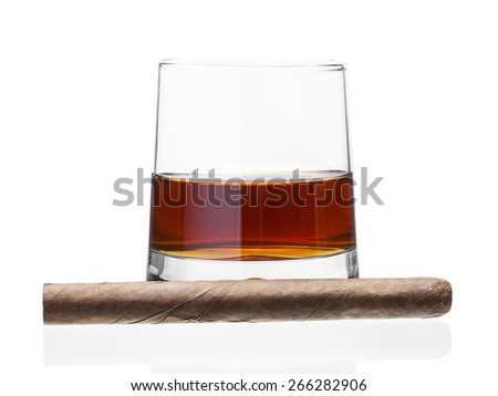 Cigar near a glass of whisky, alcoholic drink with a tobacco product on a white background, nobody. - stock photo