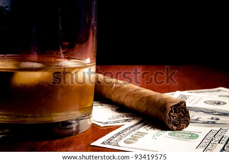 Cigar on the Dollars and whiskey