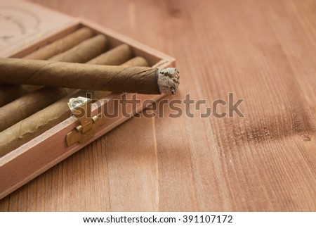 Cigar on wood background. Selective Focus