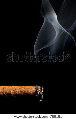 cigar smoking - macro over black with limited depth of field - stock photo