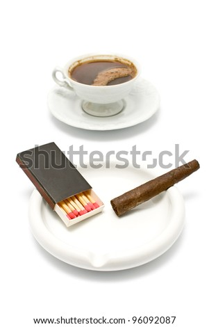 Cigar with matches and cup of coffee on white - stock photo
