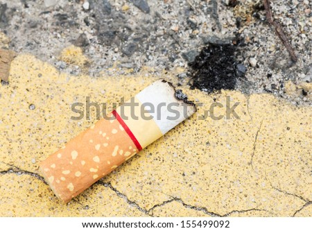 Cigarette and ash on floor.