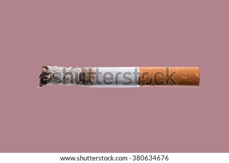 Cigarette burning on pink background, smoke addiction concept