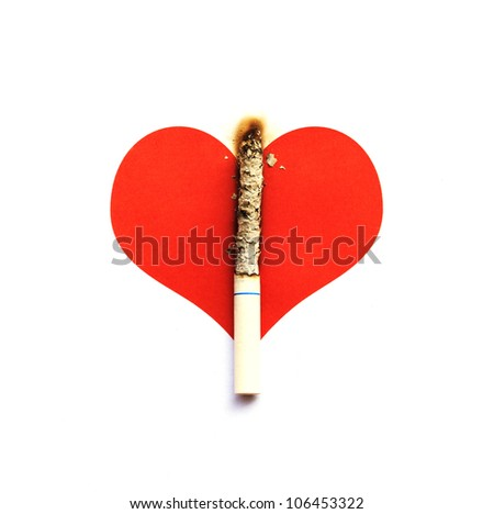 Cigarette burnt on graphic heart - stock photo