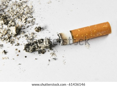 Cigarette butt and ash macro closeup - stock photo