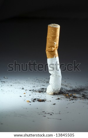 Cigarette butt end crushed into ashtray