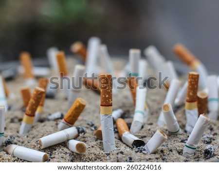Cigarette butts in the ashtray dirty. - stock photo